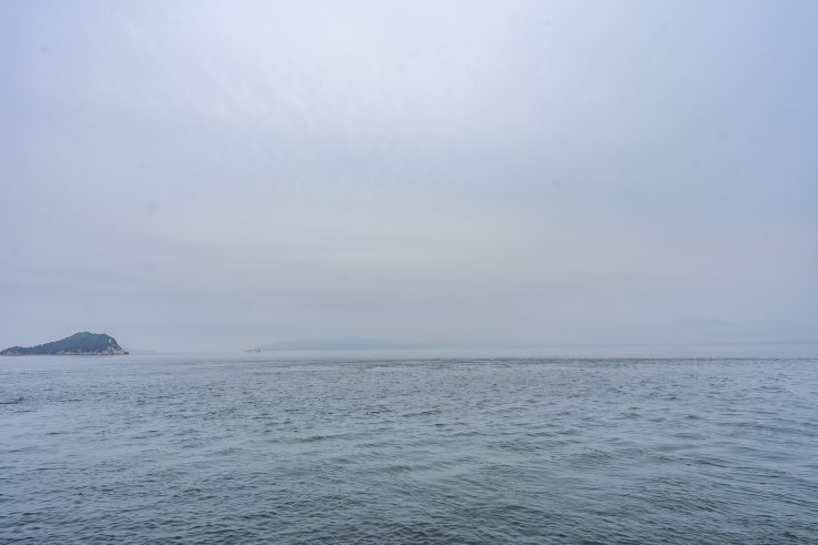 竹居観音寺岩窟から見た岡山方面